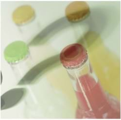 Four glass bottles filled with colored liquids (red, yellow, green, cream) with a question mark shadow superimposed above the bottle caps.