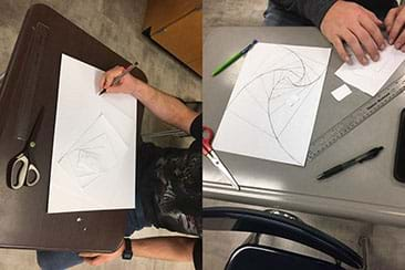 An image of students cutting out the sections and tracing the spirals.