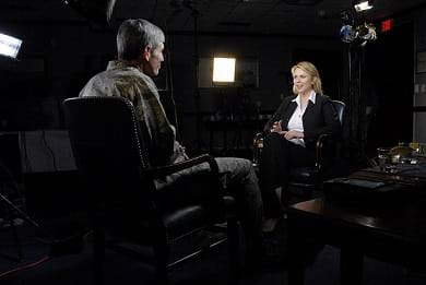 A photograph shows two people talking, face-to-face in a dark TV studio. This was a sit-down interview with Air Force Chief of Staff Gen. Norton Shwartz by Lara Logan for 60 Minutes on April 15, 2009.