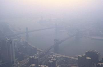 Smog engulfing the city of Manhattan, NY under air pollution.