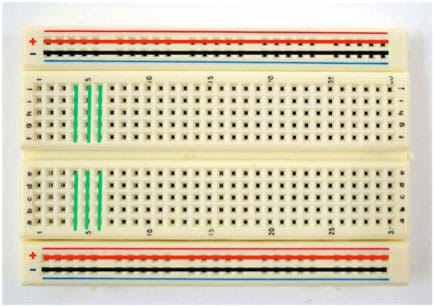 Photo shows a breadboard (circuit board) that has nothing connected to it. Colored lines are drawn over the breadboard to indicate which terminals are connected to each other.