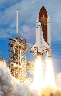 Photograph shows the take-off of a NASA rocket (space shuttle) beginning its launch to space.