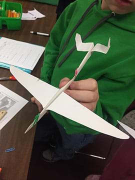 A completed paper glider made by a student.