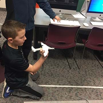 A student testing their airplane.