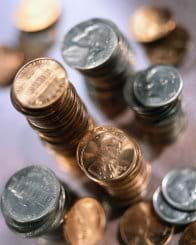 Photo shows stacks of coins.