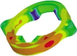 A colorful CAD drawing shows a circular part with color variations from red to orange to yellow to green to blue.