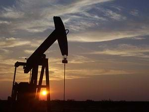 A photograph shows a pumpjack used in an oil well in Texas.