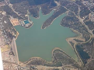 An aerial photo of the Happy Valley Reservoir in South Australia - a star-shaped body of inland water.