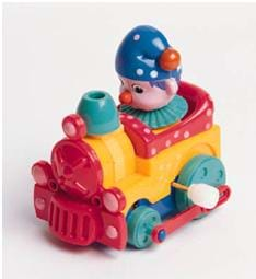 Photo shows a bright-colored plastic push-toy, a little train engine.