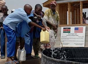 Children get clean drinking water from the Shant Abak Well built by the Naval Mobile Construction Battalion (NMCB) in Africa.