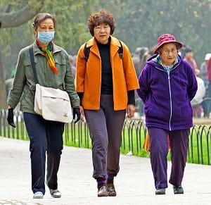 A woman wearing an air pollution mask in Beijing, China.
