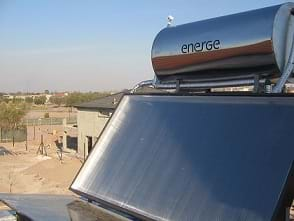 A close-coupled thermosiphon solar water heater mounted on a roof.