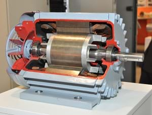 A photograph shows a machine, a Rotterdam Ahoy Eurport motor, with one side opened up to reveal a center spinning axle.