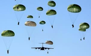 Paratroopers of the U.S. Army's 4th Brigade Combat Team parachute over the Malemute Drop Zone in Alaska.