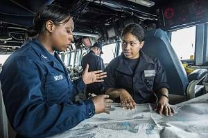 Sailors conduct navigation training aboard the USS Mustin.