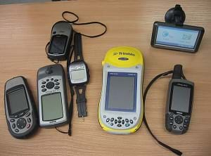 A collection of hand-held GPS receivers.