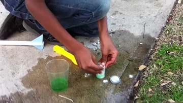A photograph shows student preparing her own fuel rocket with a film canister and antacid tablet.