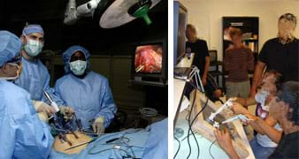 Two photos: (left) Three gowned and gloved people working over a human torso with a few medical devices puncturing it and many cables nearby, all watching a monitor showing tool movement and organs inside the abdomen. (right) Two students watch a monitor as they use their hands to control a remote camera and tools working behind a framed panel.