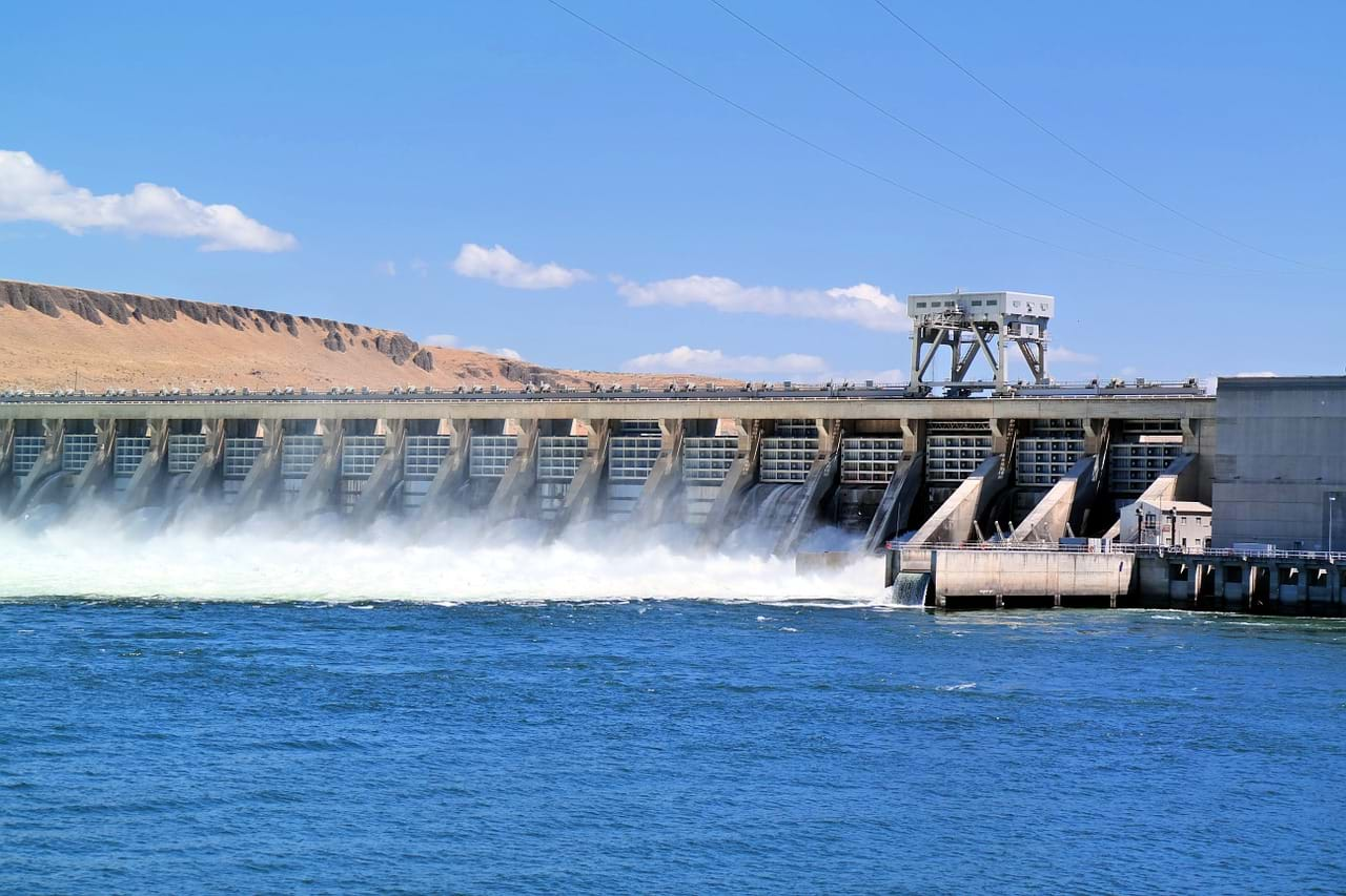 Hydroelectric dam with water going through gates.