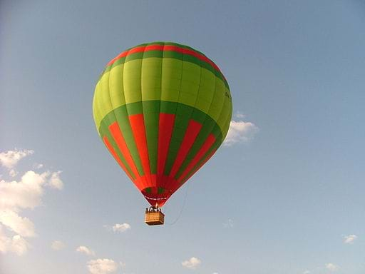 A photograph shows a hot air balloon in the blue sky.