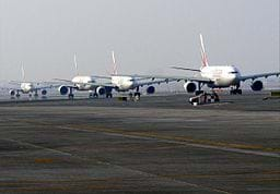 A photo shows several airplanes taxiing on the runway at Dubai International Airport in Dubai, United Arab Emirates.