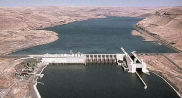 Aerial photo shows a dam across a river.
