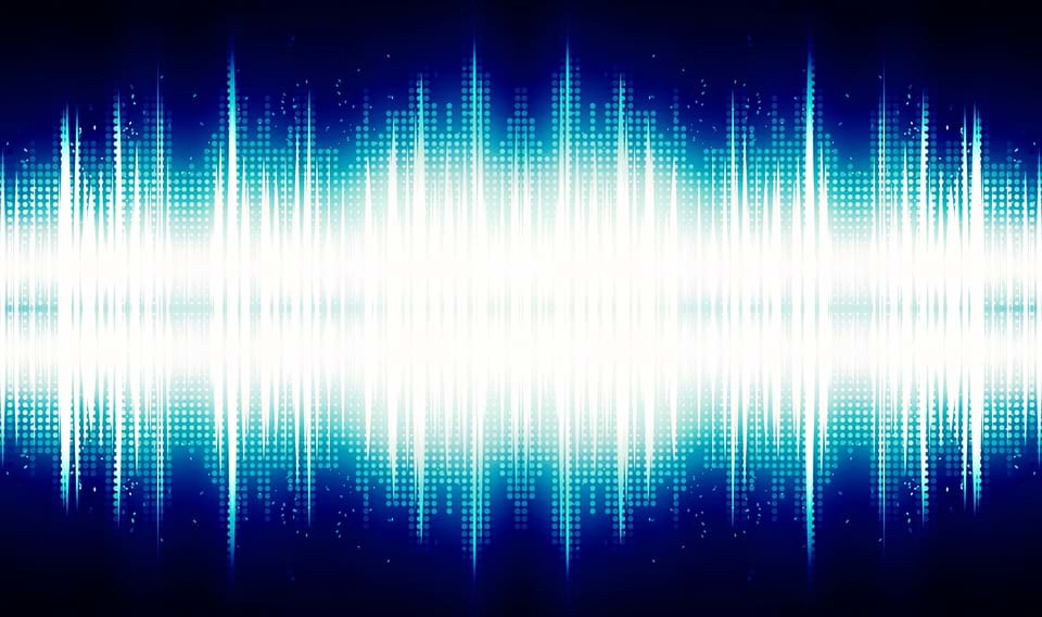 A blue and white audio sound wave.