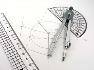 A photograph shows geometry tools: a compass, protractor, calipers and set square. The tools lay on a drawing with lines, circles and angles that was created with the tools.