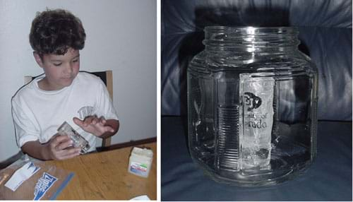 Two photographs. In one, a child spreads petroleum jelly on the outside of a small glass jar. The second photograph shows the small glass jar placed inside a large glass jar.