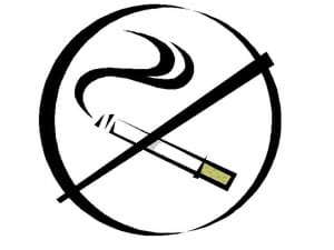 Graphic of a smoking cigarette in a circle with a bold crossed out line over it.