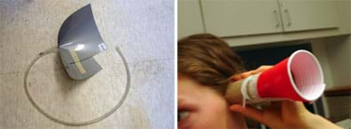 Two photos of ear trumpets, one made from flexible gray plastic material cut and folded like a cone and taped to keep its shape with a length of 0.7 cm clear rubber tubing attached to the point of the cone (left), and another made from a sliced plastic picnic cup taped to a cardboard paper towel tube, held up to a student's ear (right).
