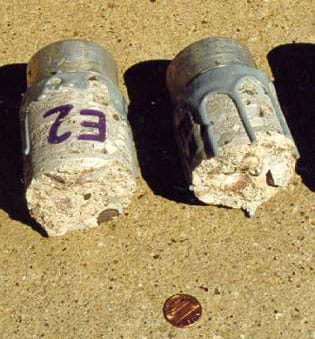 Photo shows a hand-sized cylinder of concrete, broken in half.
