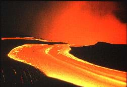 A photograph shows a flow of hot orange lava.