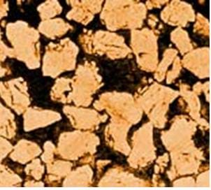 A microscopic image shows what looks like the end of a stack of wood, with all spaces between the wood being black with trapped oil between the grains.