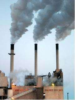 A photograph of a coal electric power plant Shown are three smoke stacks that have huge plumes of greenhouse gas (sulpher and mercury) emissions.