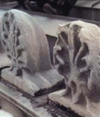 A picture of two pieces of building ornaments. Both pieces show deterioration, the effect of acid rain.