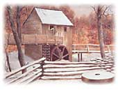 A photograph shows a rough wood building with large wooden water wheel partially immersed in a snow-covered river.