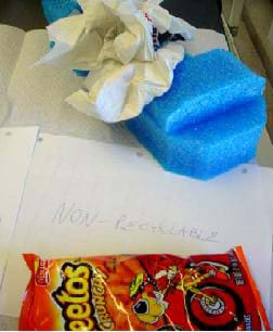 Photo shows packing foam, snack chip bag, and paper towels.