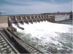 A photograph shows the gates of a hydropower dam