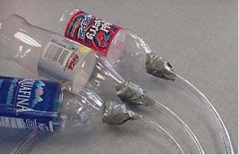 A photograph shows three different test bottle setups with varying diameter tubes.