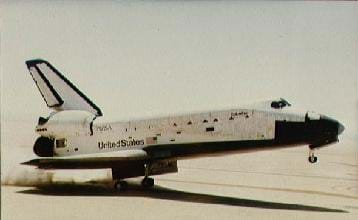 Photo shows an aircraft with side wings and upper rudder rolling on its back wheels with the nose silghtly up.