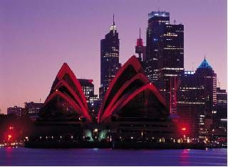 Photograph of an Olympic city, Sydney, with a view of the Opera House and skyscrapers in the background.