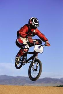 A photograph of a BMX bike in the air. Its lightweight construction allows BMX racers to achieve great height when jumping during competition.
