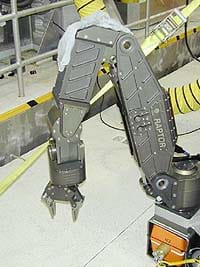 A picture of a robotic arm kit with five degrees of freedom.