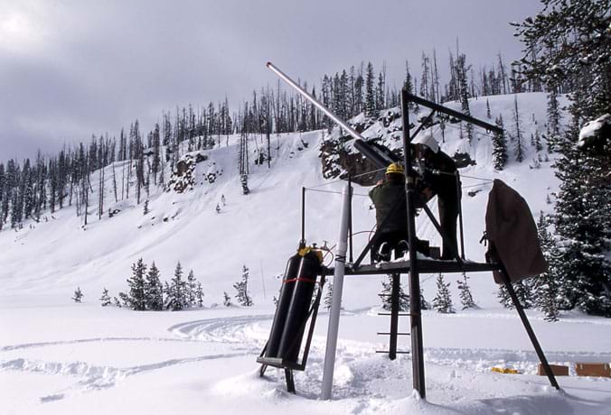 Photo of a snowy mountain scene with a metal contraption in the foreground.