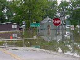 A street intersection is submerged in water.