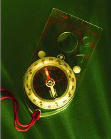 A photograph of a compass on a lanyard.