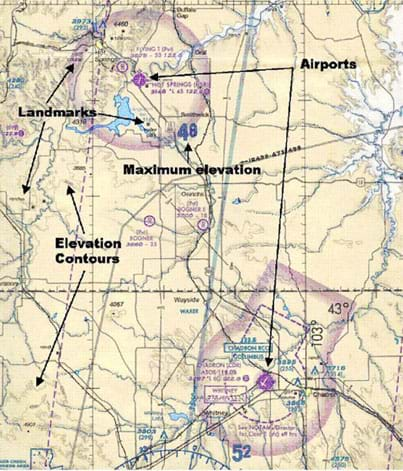 A portion of an aeronautical chart showing land and water areas, marked with elevations, elevation contour lines, airport airspace boundaries, roads and other identified landmarks.