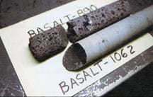 Photo of two rock cylinders of basalt, one porous and the other smooth.