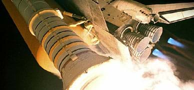 Photo shows the rear of the space shuttle with the rocket nozzle shaped like a bell, increases in diameter at the end.